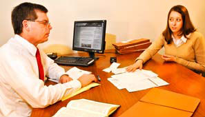 Attorney and client going over documents