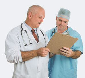 doctor and surgeon look at clipboard